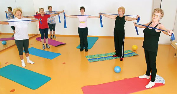 Seniors at an assisted living facility exercise class